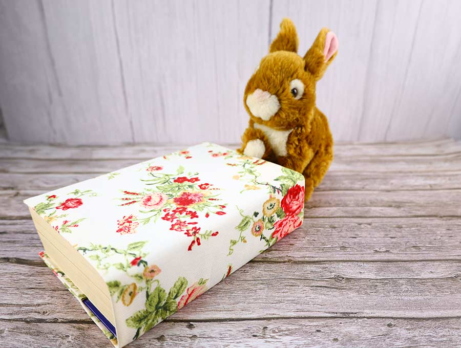 bunny using a book with fabric book cover