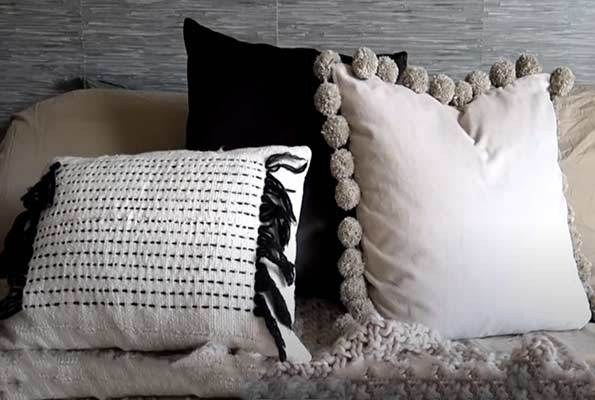 aestetic throw pillow with pom poms