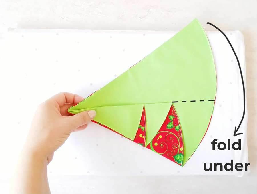 how to fold the christmas tree napkins - step 3
