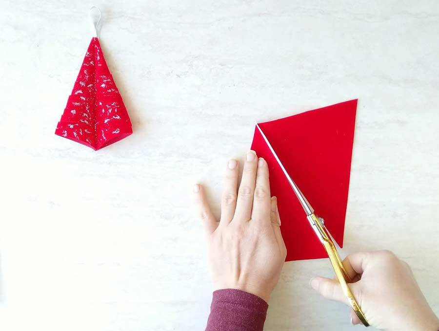 chirstmas tree ornament cutting the fabric