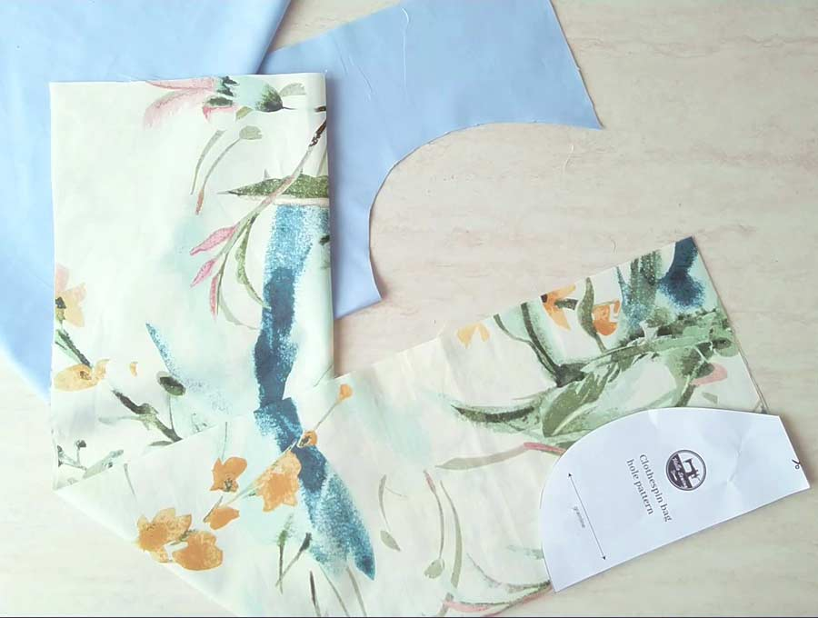 cutting out the clothesline bag pattern out of both fabrics