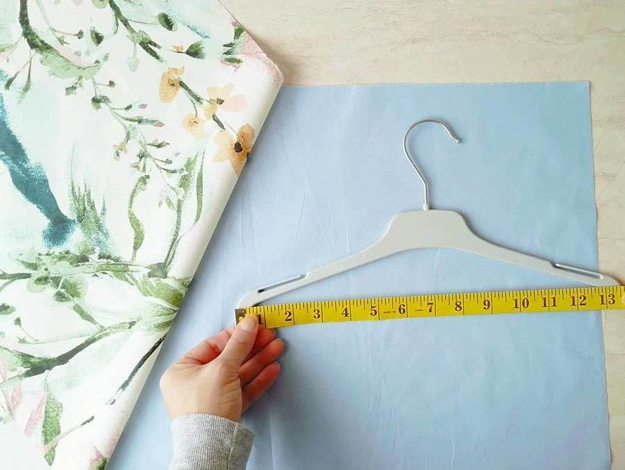 measuring the hanger to sew the clothespin bag