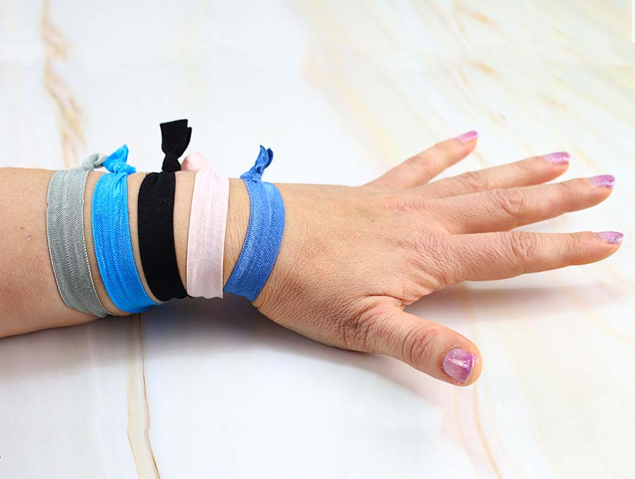 diy elastic hair ties on a hand