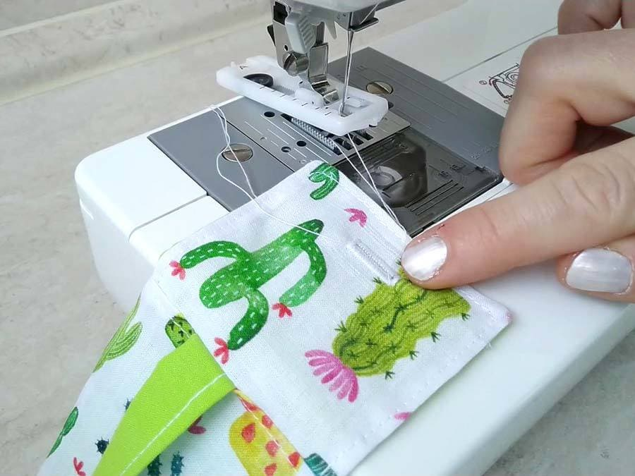 sewing the buttonhole on the flap of the hand gel pouch
