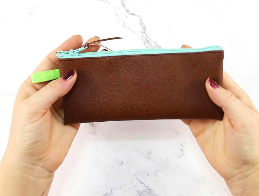 hands holding the diy pencil case