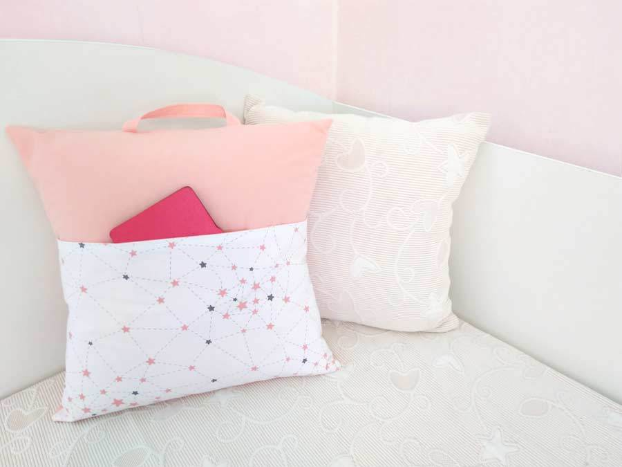 pocket pillows on the bed with an e-book at the front