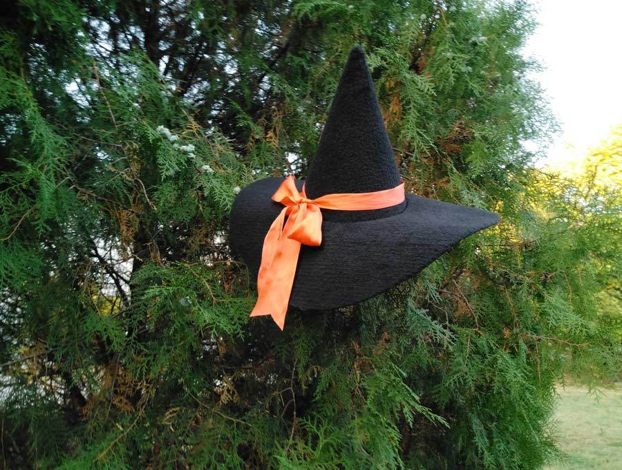 finished diy witch hat hanged on a tree