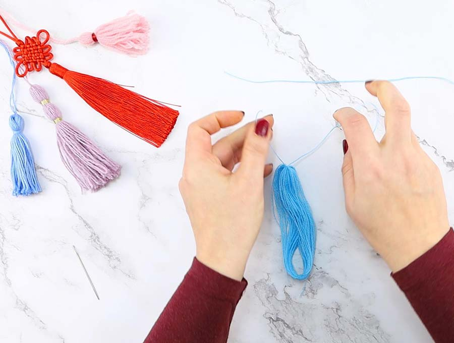 tie the top of the diy yarn tassel