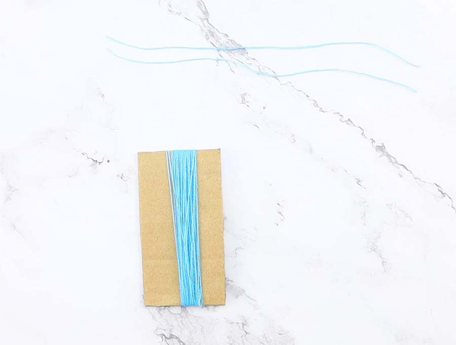 diy yarn tassel - winding to a cardboard