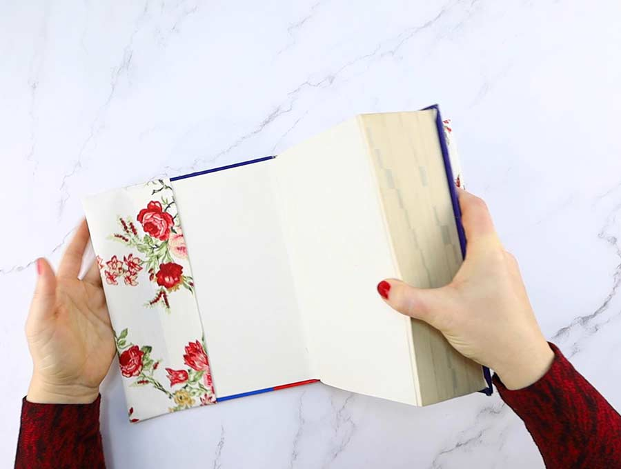 inserting a book into the fabric book cover