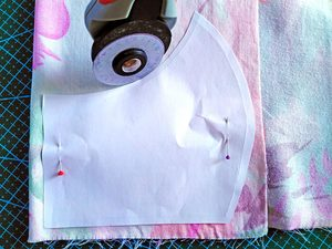 cutting the outer layer of the face mask according to the pattern