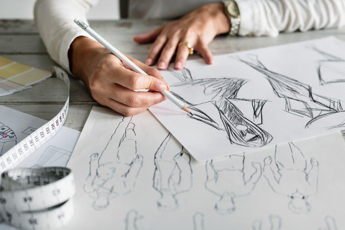 fashion designer sketching a garment