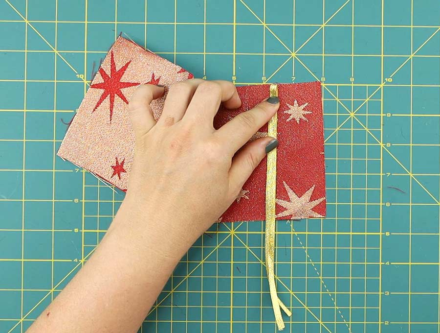 adding ribbon to the top of the diy gift card holder