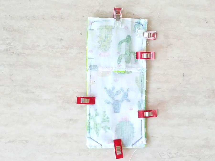 layered fabrics pinned before sewing the hand sanitizer pouch