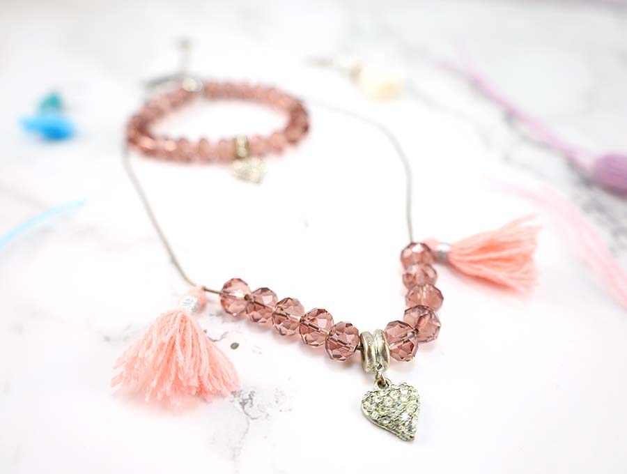 handmade tassels attached to jewelry