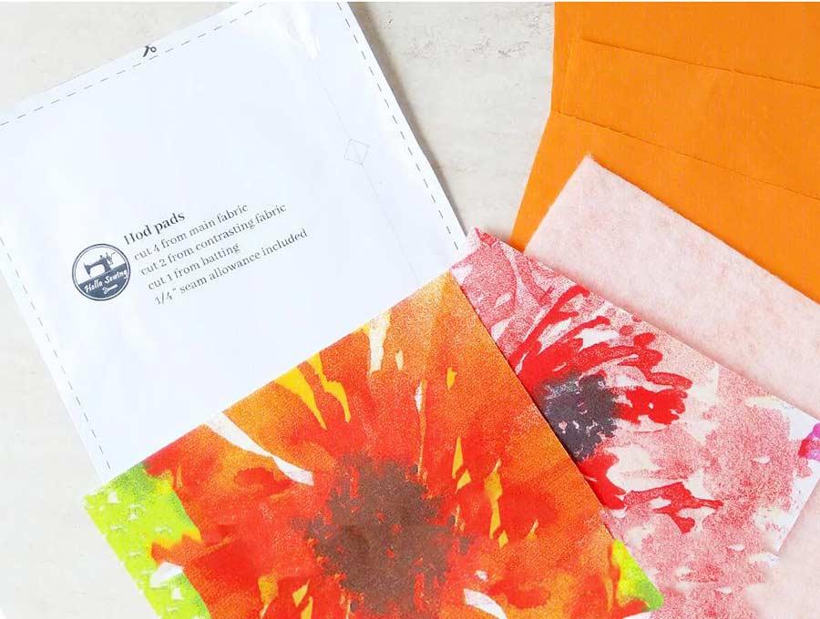 Hot pad sewing pattern and cut fabrics to make diy hot pads