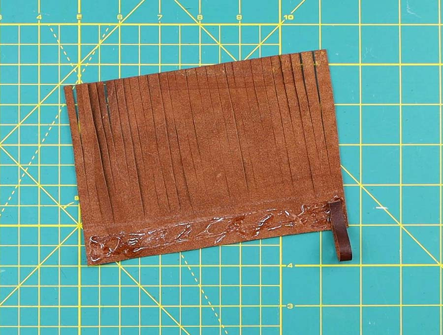 adding loop to the leather tassel