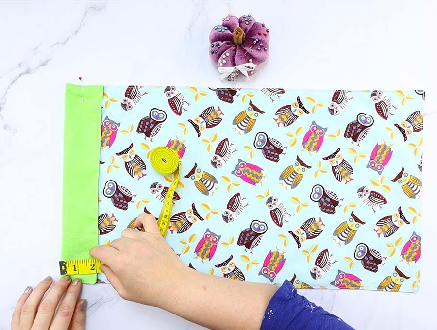folding top to make microwave popcorn bag