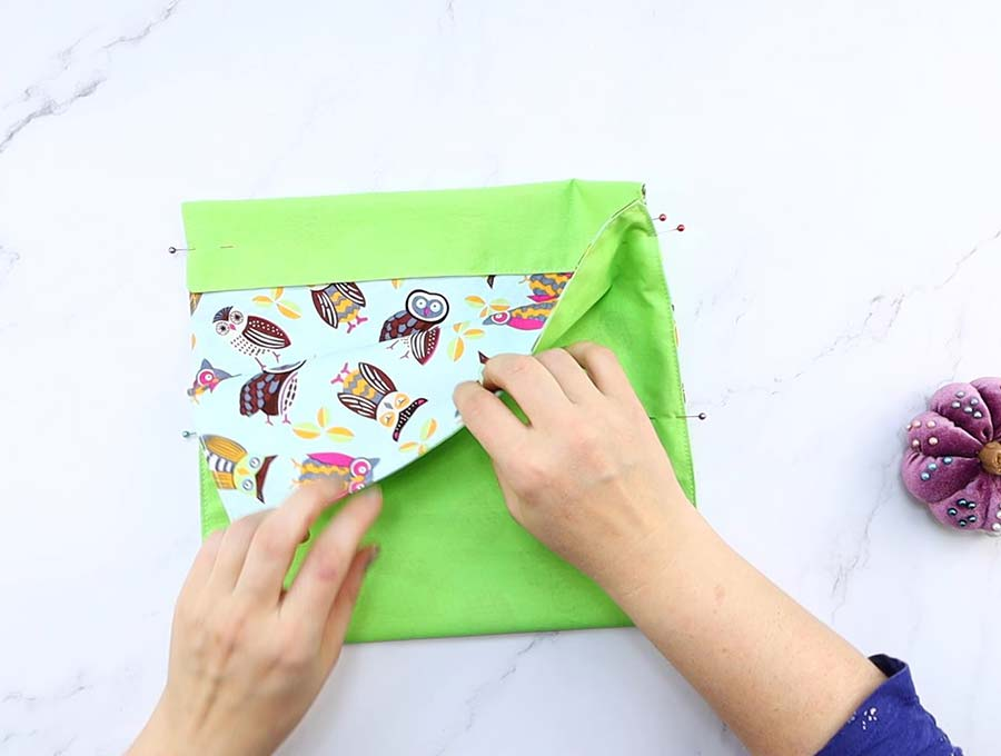 pinning the sides of the microwave popcorn bag