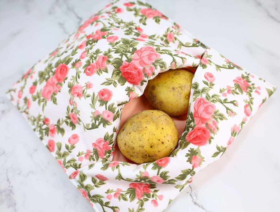 microwave potato bag with raw potatoes inside