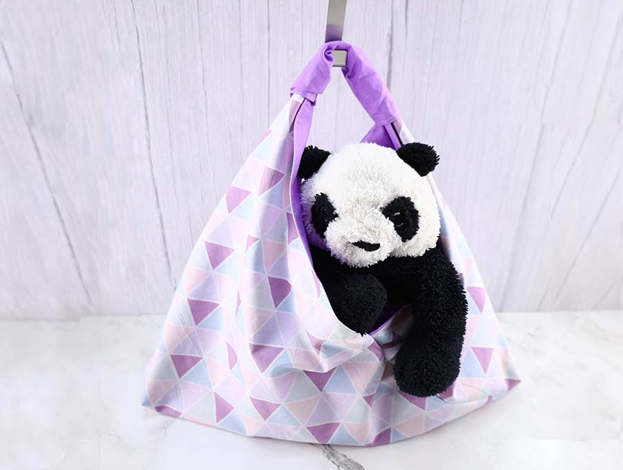 origami bag with plush toy inside