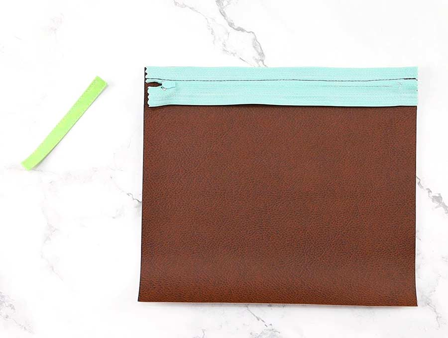 sew the zipper to the pencil pouch