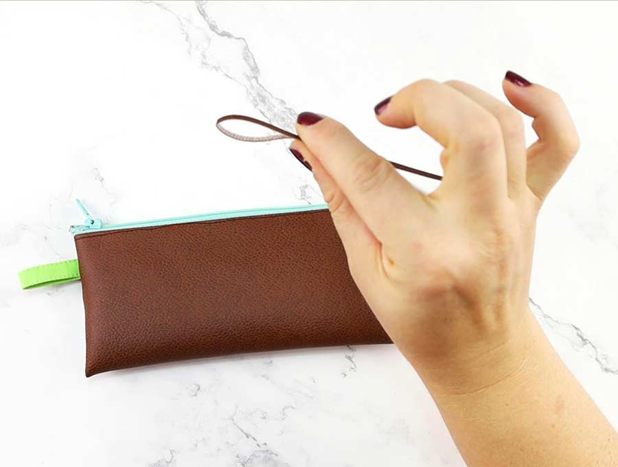 add leather pull tab to the pencil case