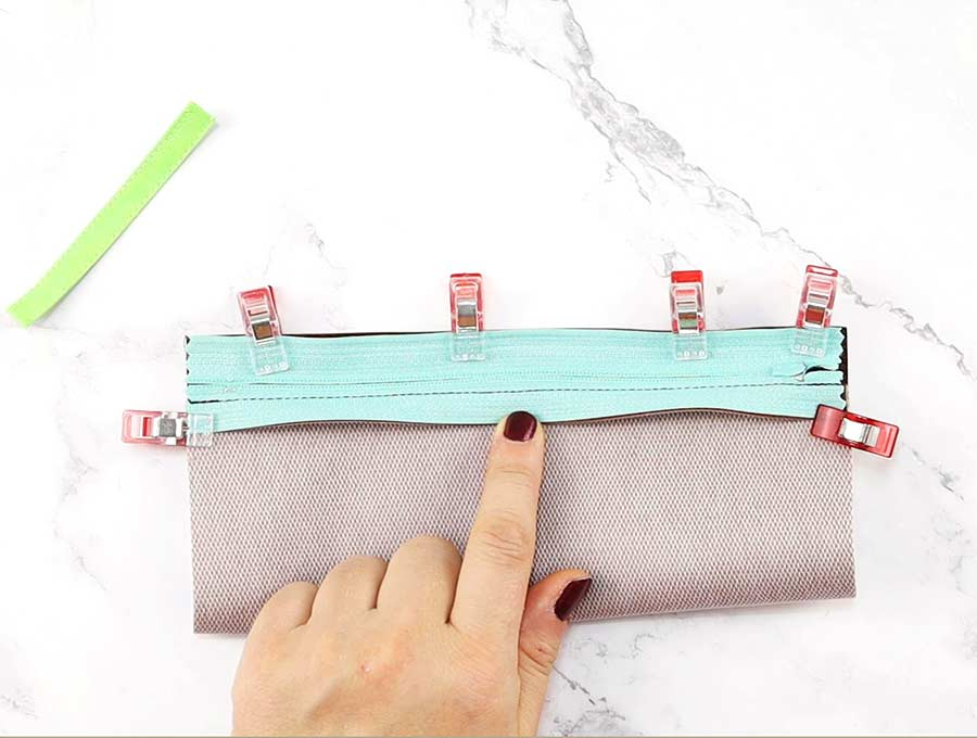 pin the zipper to the homemade pencil pouch