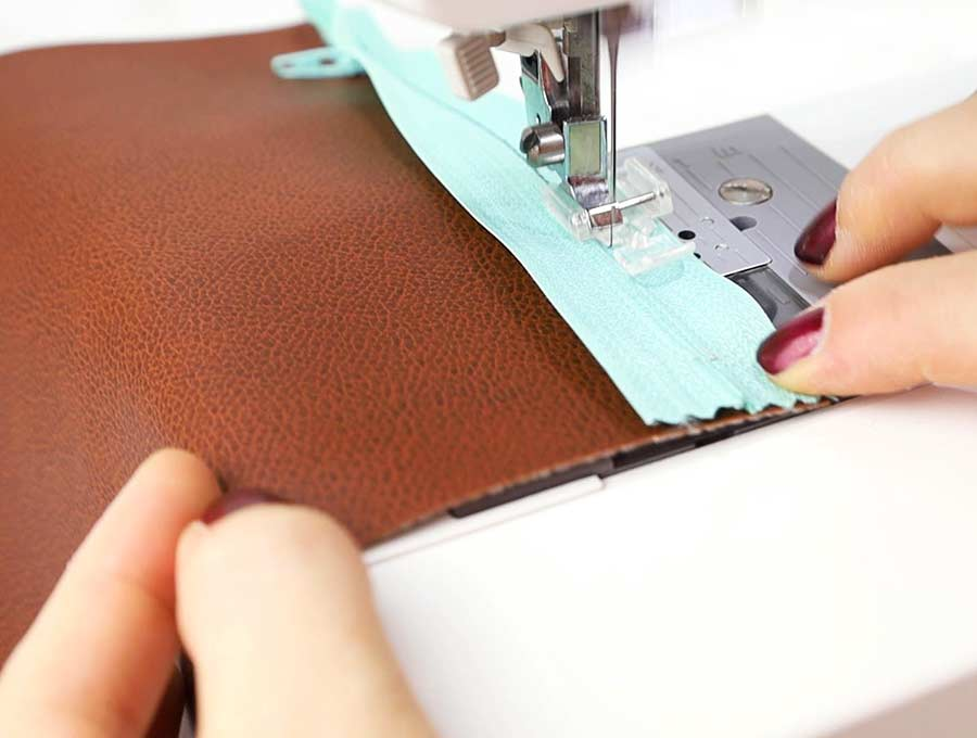 sewing the zipper of the pencil case