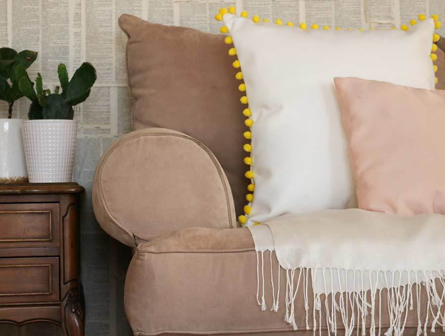 pom pom leather throw pillow