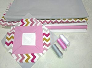 quilt block in front of quilting fabrics and thread