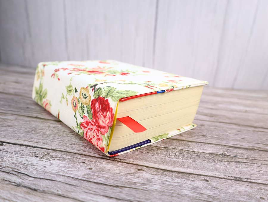 sew a book cover with a bookmark