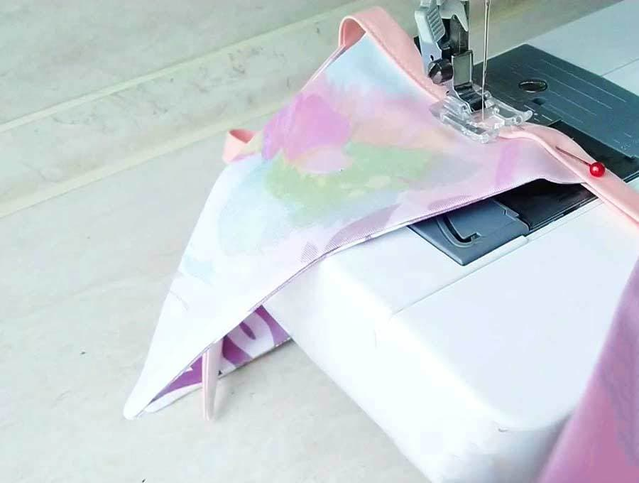 sewing bunting flags to tape