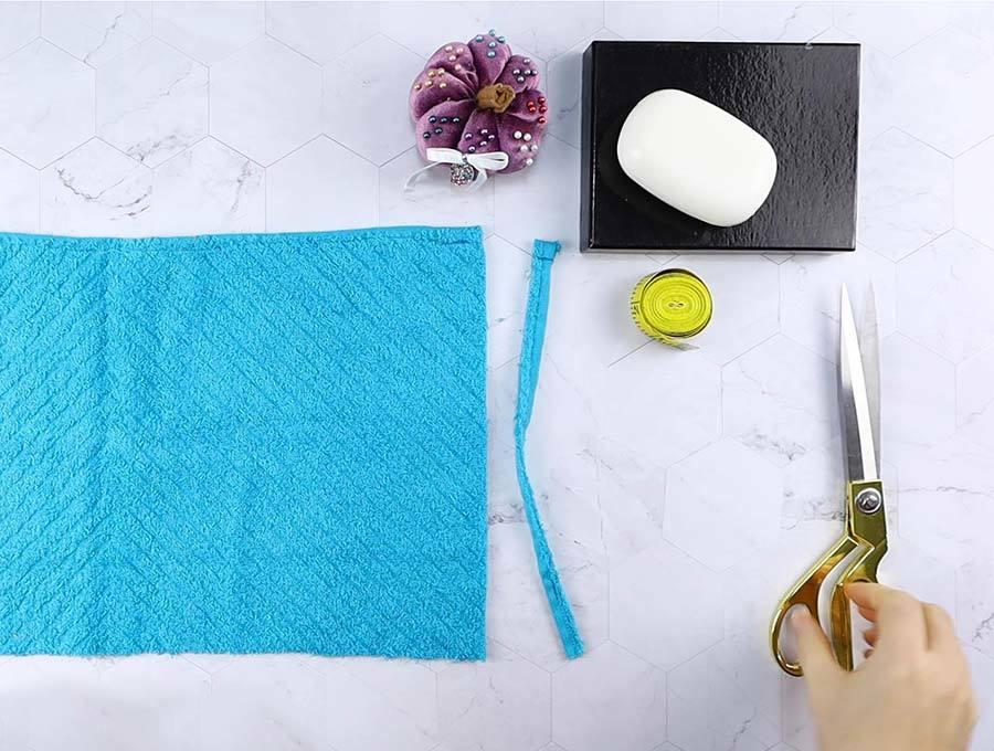 removing hemmed side of washcloth to make soap saver
