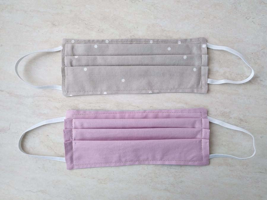 two surgical masks side by side
