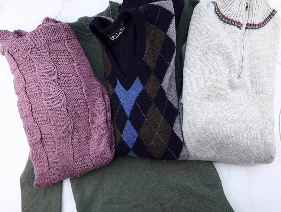 choosing wool sweater to make recycled mittens