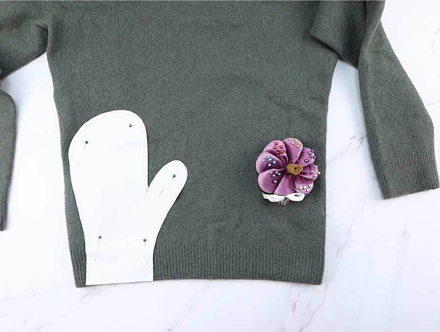 mittens pattern pinned to sweater