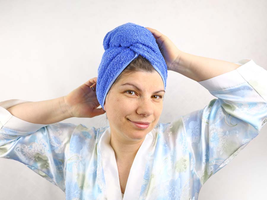 diy towel turban with a button on woman's head