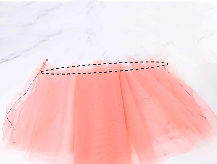 basting the top of the diy tulle skirt