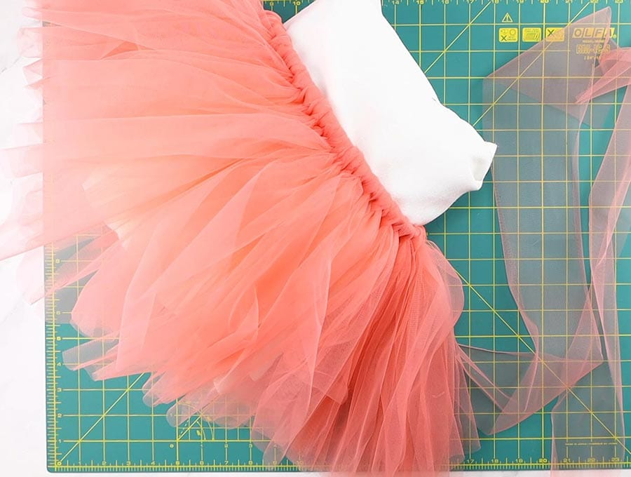 making of the tutu skirt - knotting the tulle strips on the elastic waist